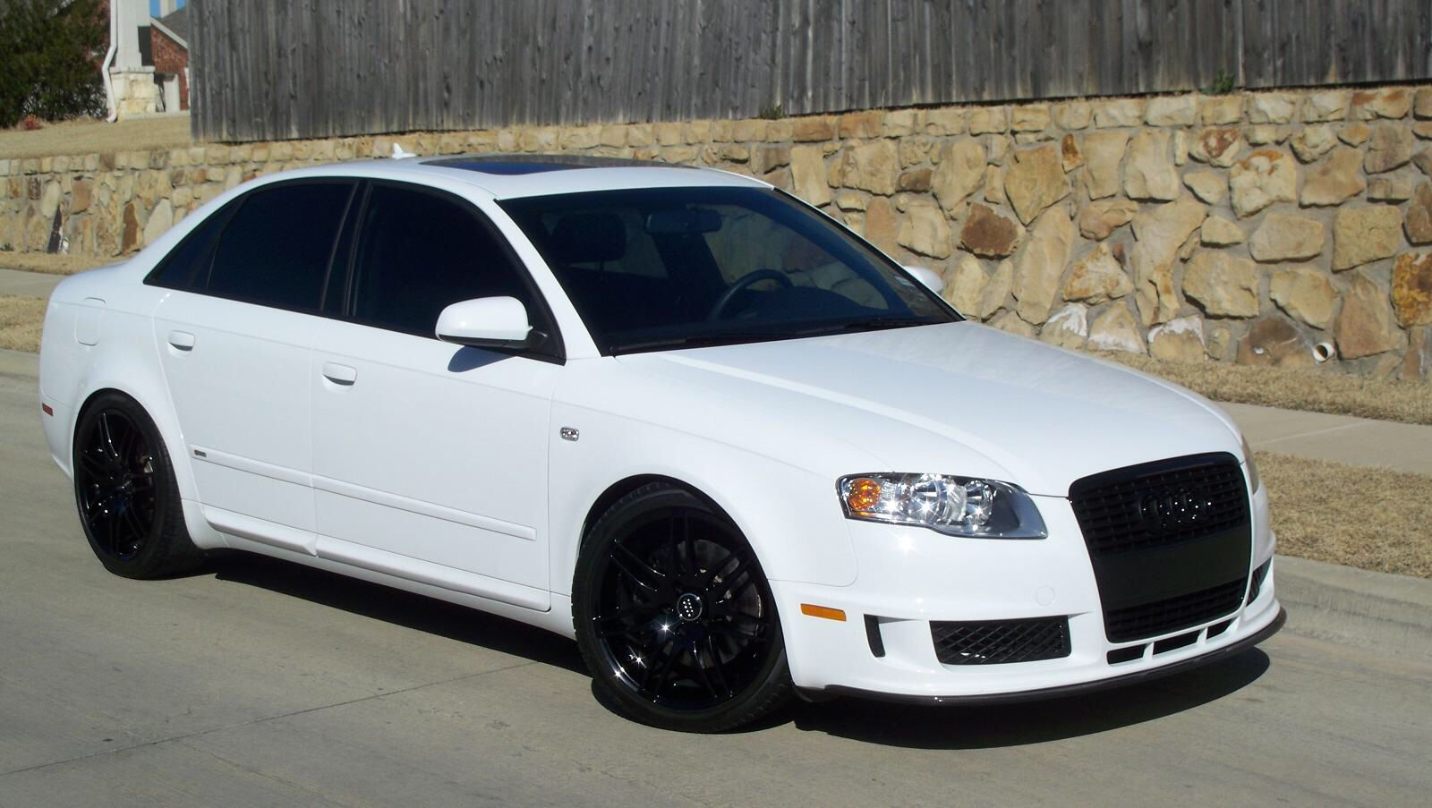 White Audi a4 with black rims