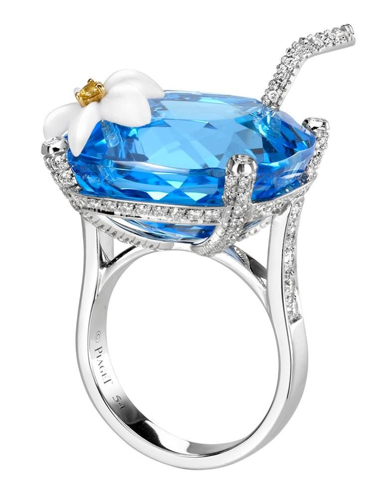 blue topaz jewerly ring (white gold)  with a straw and a Sak Nikté (white plumeria), with chalcedony petals and a yellow-sapphire heart. Blue hawaiian http://www.piaget.com/jewelry/white-gold-chalcedony-diamond-ring-g34lm200