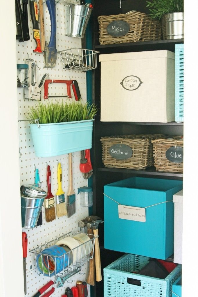 Could possibly do something like this in my storage room inside my Idaho apt. So pretty. Love all the colors to brighten a dull room that houses a heater and a water softener. Perhaps install pegboard over the workbench to house paint brushes and tools.