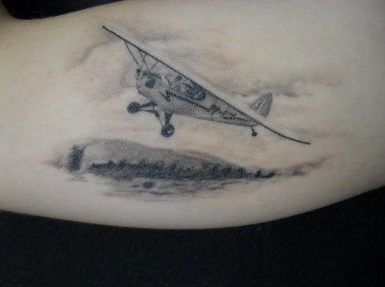 Plane flying over island tattoo