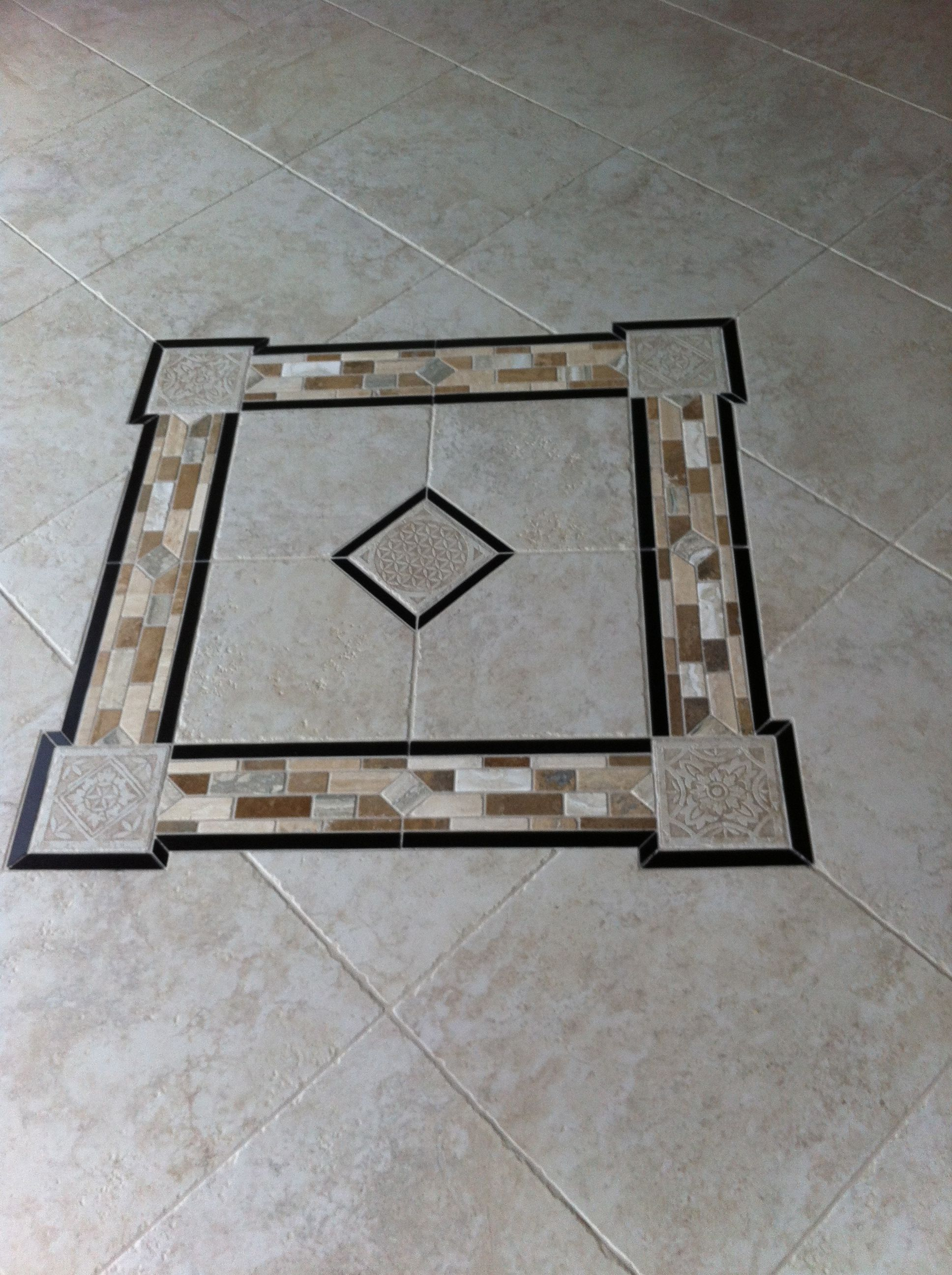 Porcelain Granite And Travertine Design As Center Piece Of Front Porch Purchased From Tile America