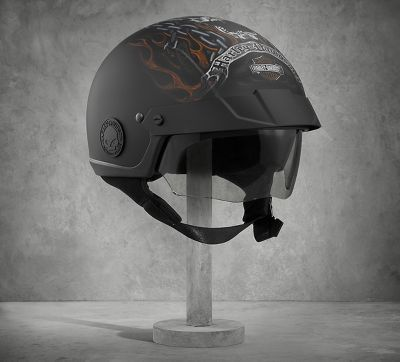 The edgy graphics on the Shields Avenue Sun Shied H02 Half Helmet is one of our most sinister to date. But this matte black motorcycle half helmet has more going for it than an awesome, drooling skull. Washable, antibacterial liner…pull-down retractable sun shield…back exit vents and so much more. Read all the features listed below...