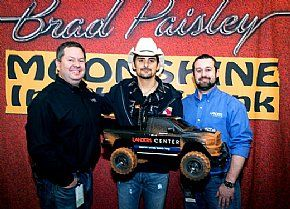 The venue's Todd Mastry and Joel Crews present Brad Paisley with a memento when his tour rolls through Landers Center in Southaven, Miss., Jan. 22.