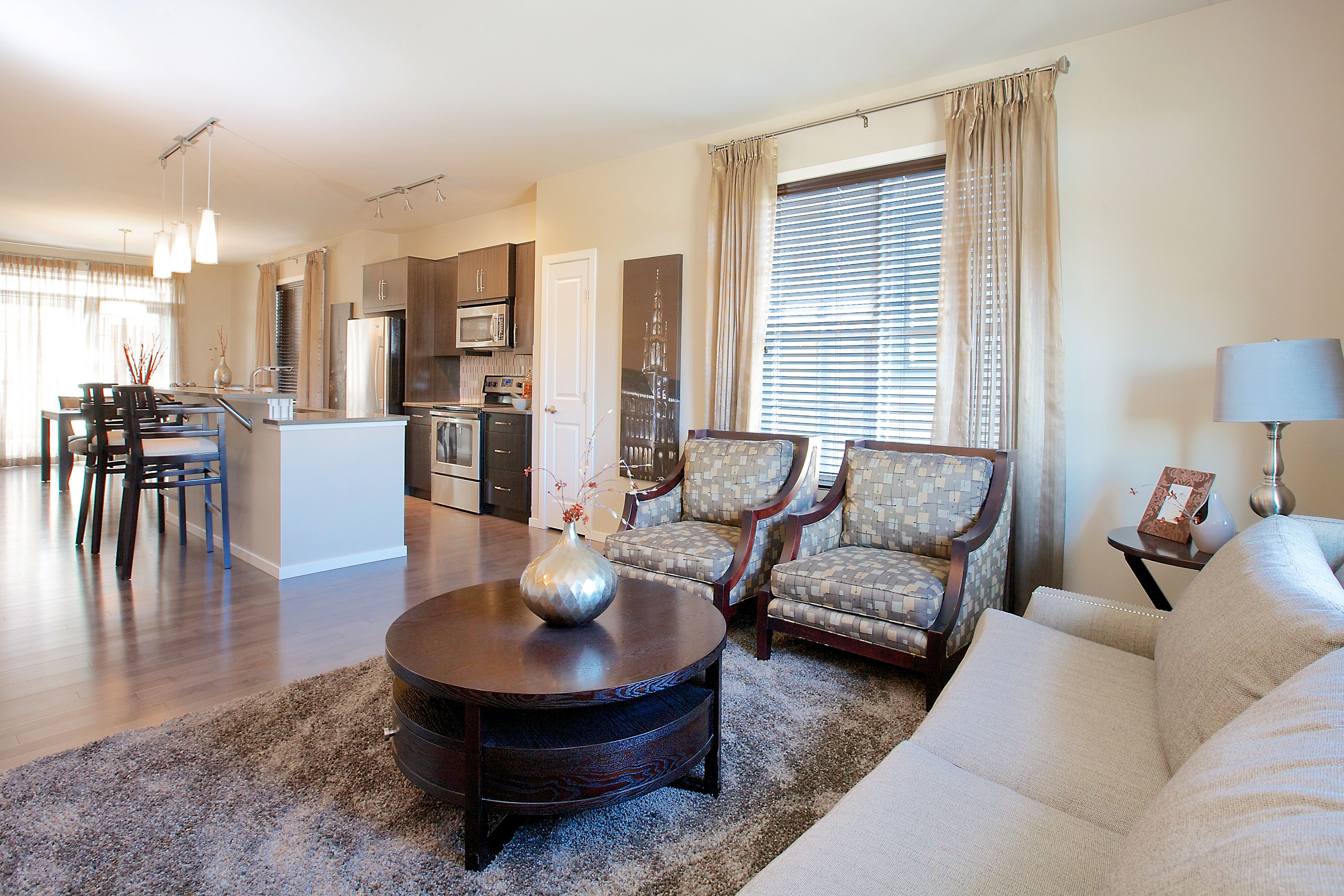 crisp neutral living room at the enclave at castle keep by avi urban