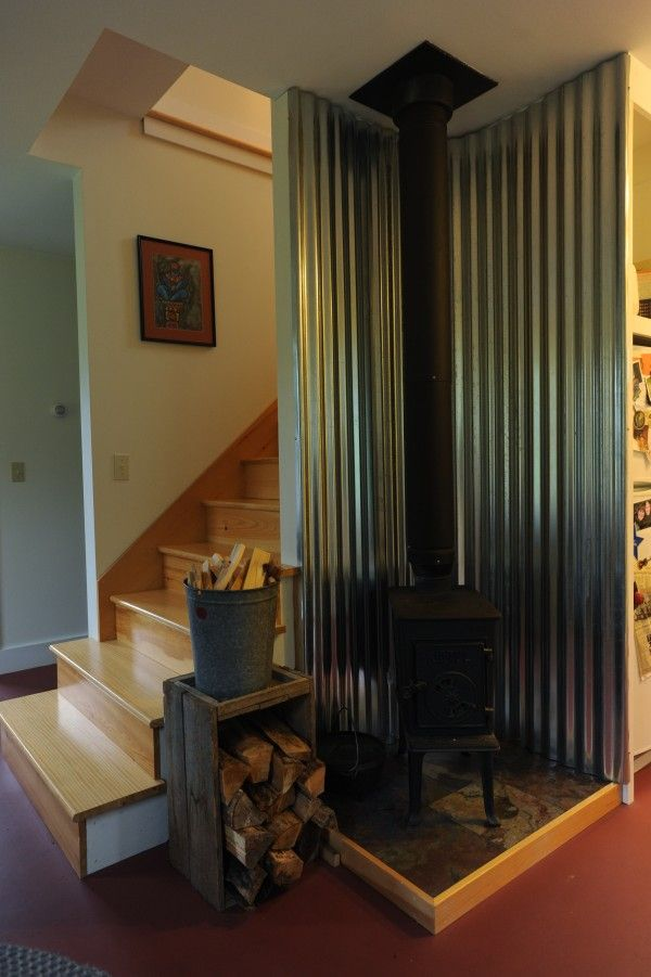 Cool wall behind wood stove. Love the wood storage too. Google ...