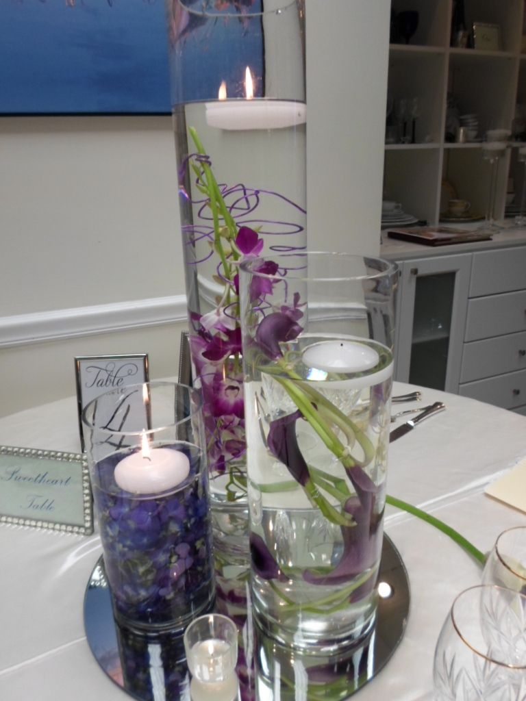 Simple yet elegant purple floral centerpieces cream and white