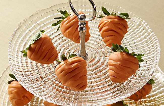 Disguise sweet strawberries as bunny-friendly carrots! Dip fresh strawberries into melted white chocolate colored with orange gel-based or oil-based food coloring. Using a wooden pick, create a few lines on strawberries to resemble a carrot, then cool completely before your little bunnies start munching.