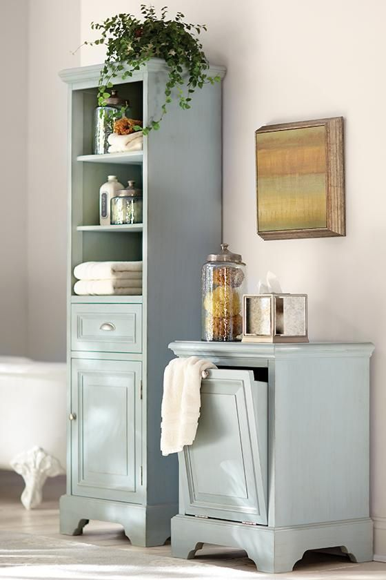 decorate your bathroom with a linen cabinet and hamper that are both pretty and practical