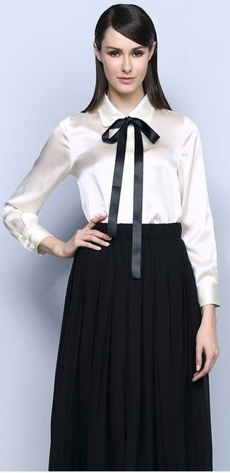 Dressed For Work In White Blouse Black Bow And Long Black Skirt