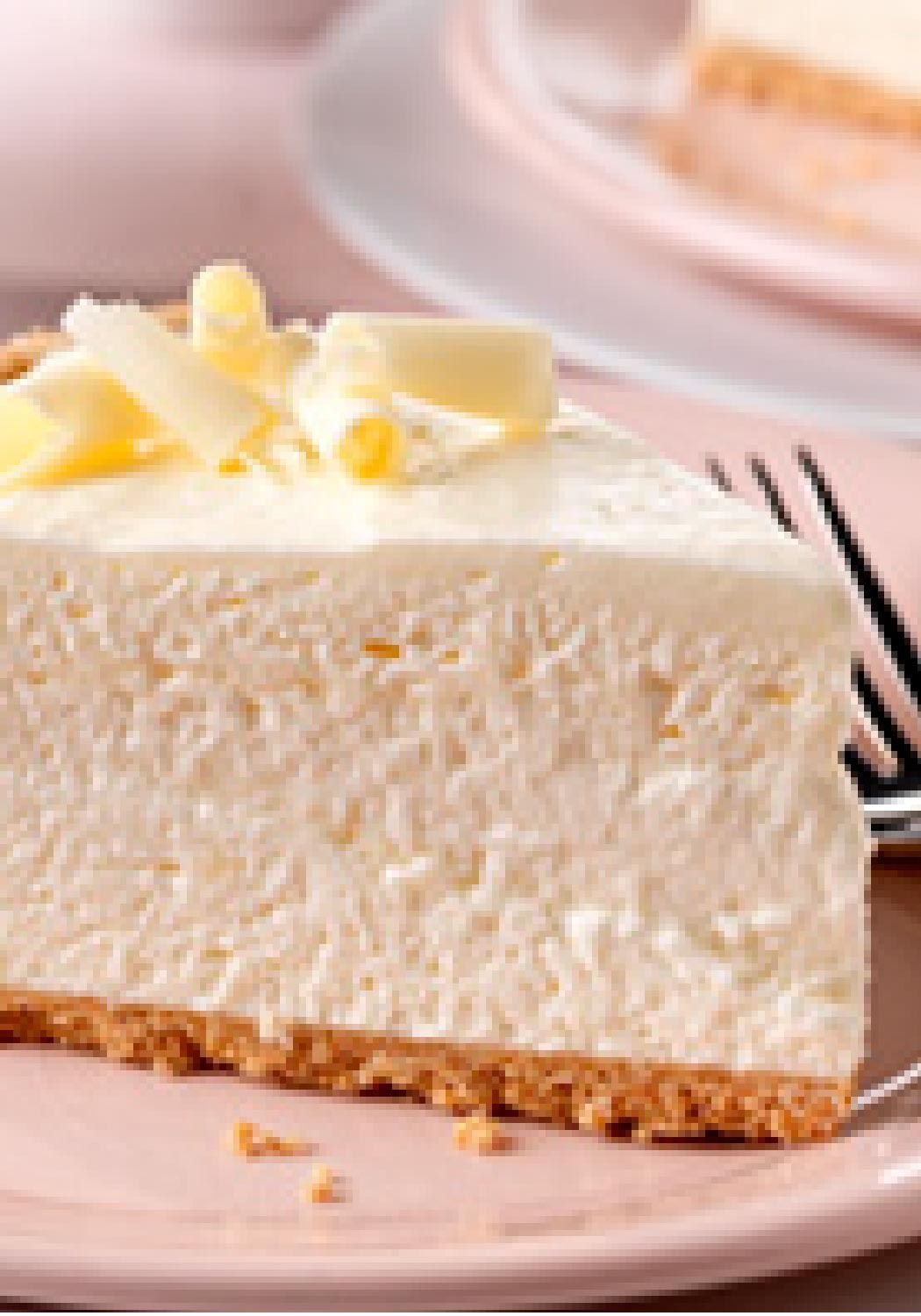 Fluffy White Chocolate Cheesecake A Filling Of Cream Cheese White Chocolate Flavor Pudding And Whipped Topping Desserts Cheesecake Recipes Fluffy Cheesecake
