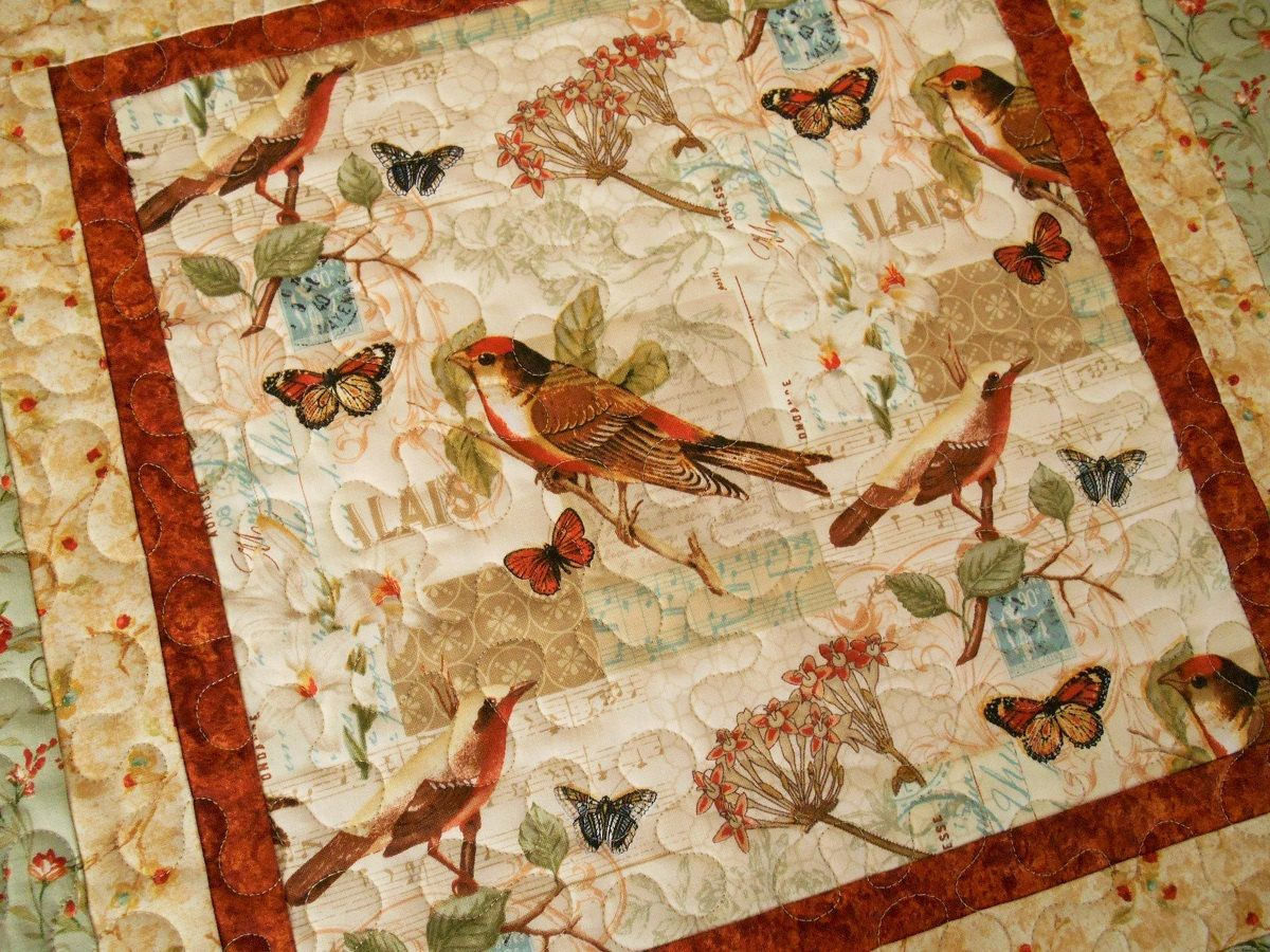 Quilted Table Topper With Birds Butterflies And Flowers In Rust Blue Brown And Quilted Table Toppers Etsy Quilts Quilted Table Runners
