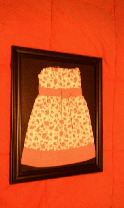 One of my daughters 1st dresses framed to hang on the wall. Thought it was a cute idea