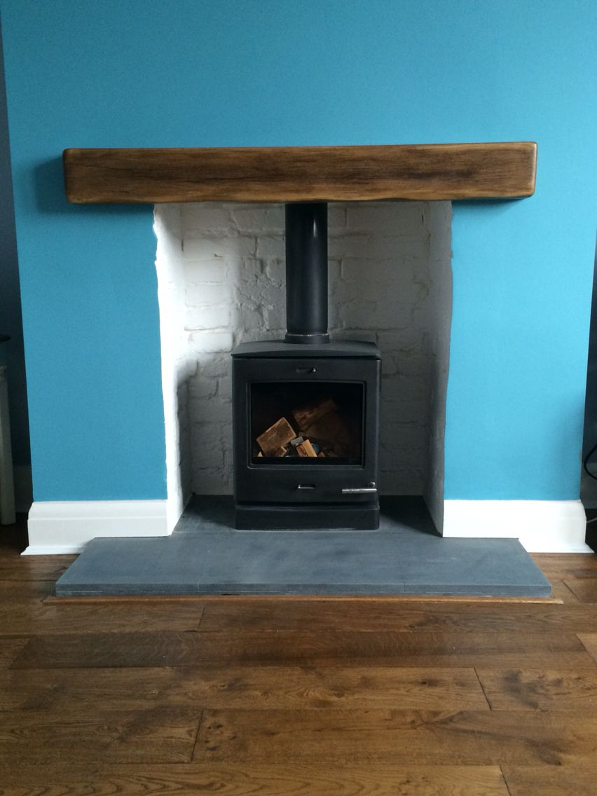 finished fire place hand painted white bricks black yeoman stove
