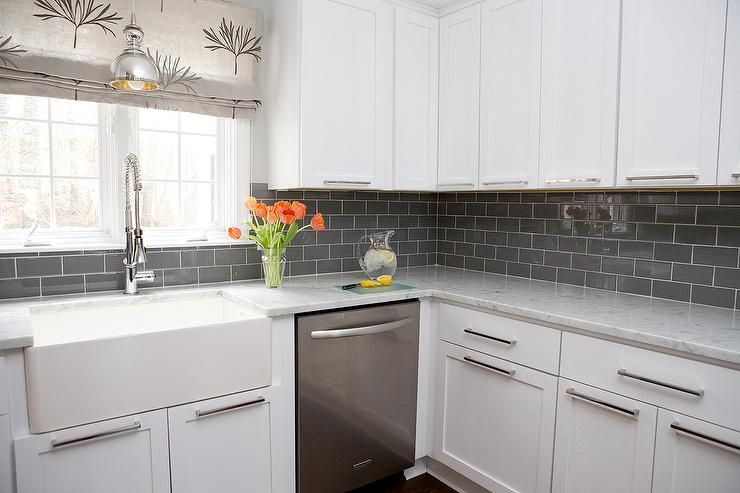 contemporary kitchen features white shaker cabinets paired with grey and white countertops and a gray subway gray subway tile backsplashgrey - White Kitchen With Subway Tile Backsplas