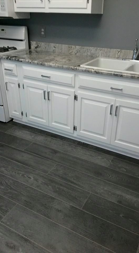 Love the grey and white combination in this kitchen from for Grey floor black cabinets