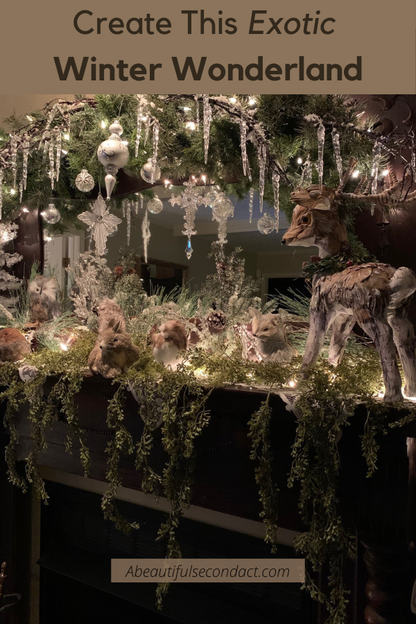 Create a Winter Wonderland on your mantle this Christmas. Learn how to use green branches, drippy icicles, and forest animals to create this gorgeous forest scene. The right ornaments will reflect each of your tiny white fairy lights. #winterwonderland #winterforest #whitechristmas