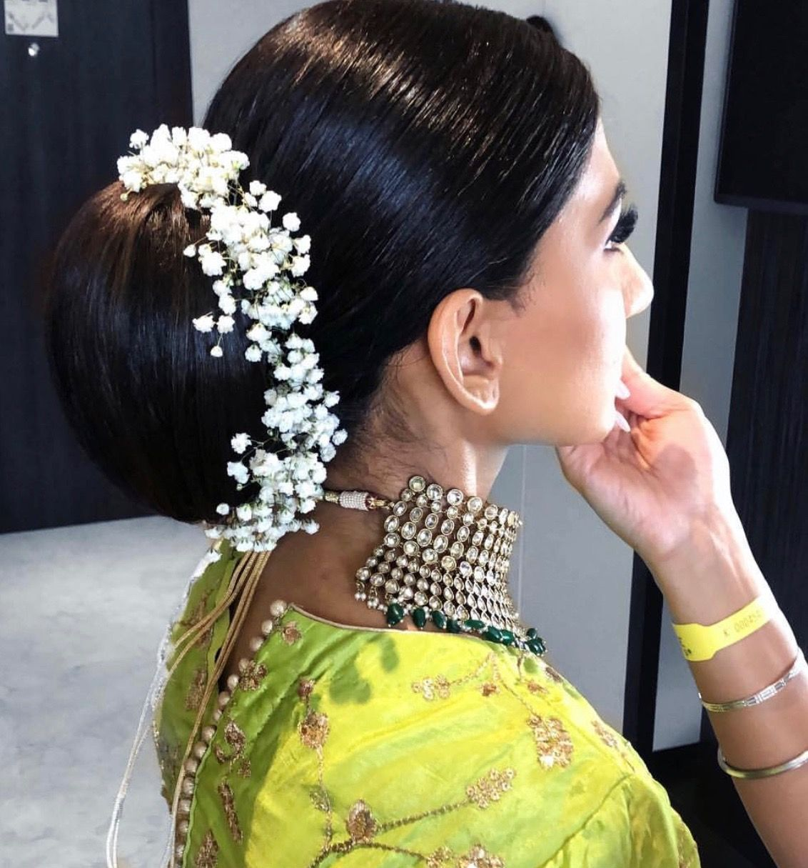 What A Beautiful Large Low Bun With Real Flower Gajra Care However Should Be Taken Before Adopting Such Hairstyles A Bridal Hair Hair Styles Bride Hairstyles