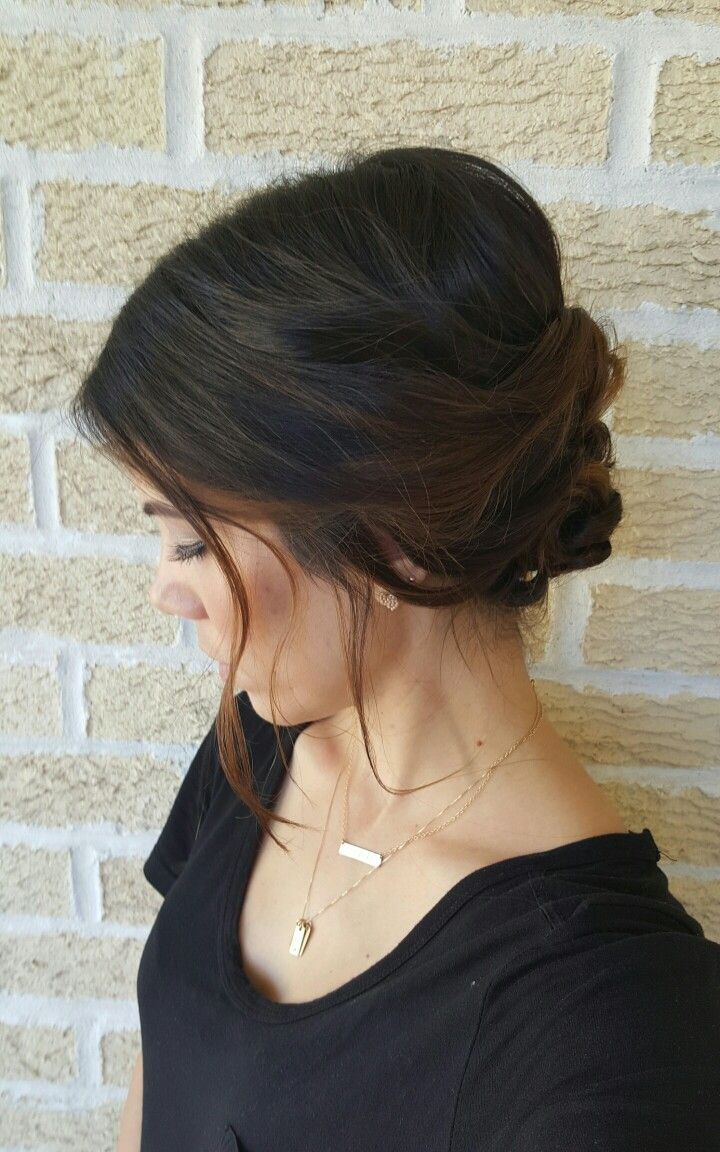 Loose wispy romantic twisted bun upstyle hair hairstyle