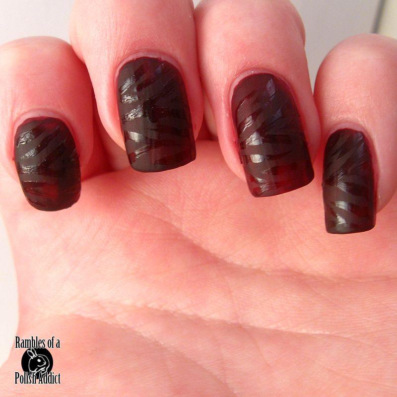 Matte nails with shiny zebra print