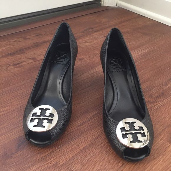 Never worn Tory Burch Black Leather Wedges!  Never worn pair of wedges from Tory Burch! Black leather with silver TB logo. These are peep toe! No trades please  Does not come with box. Tory Burch Shoes Wedges