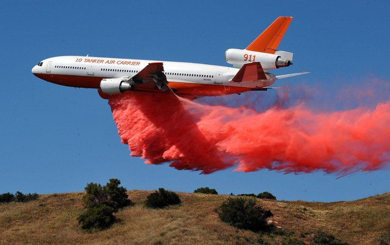 10 Tanker DC-10 dropping fire retardant at low altitude to help combat forest fires out West.