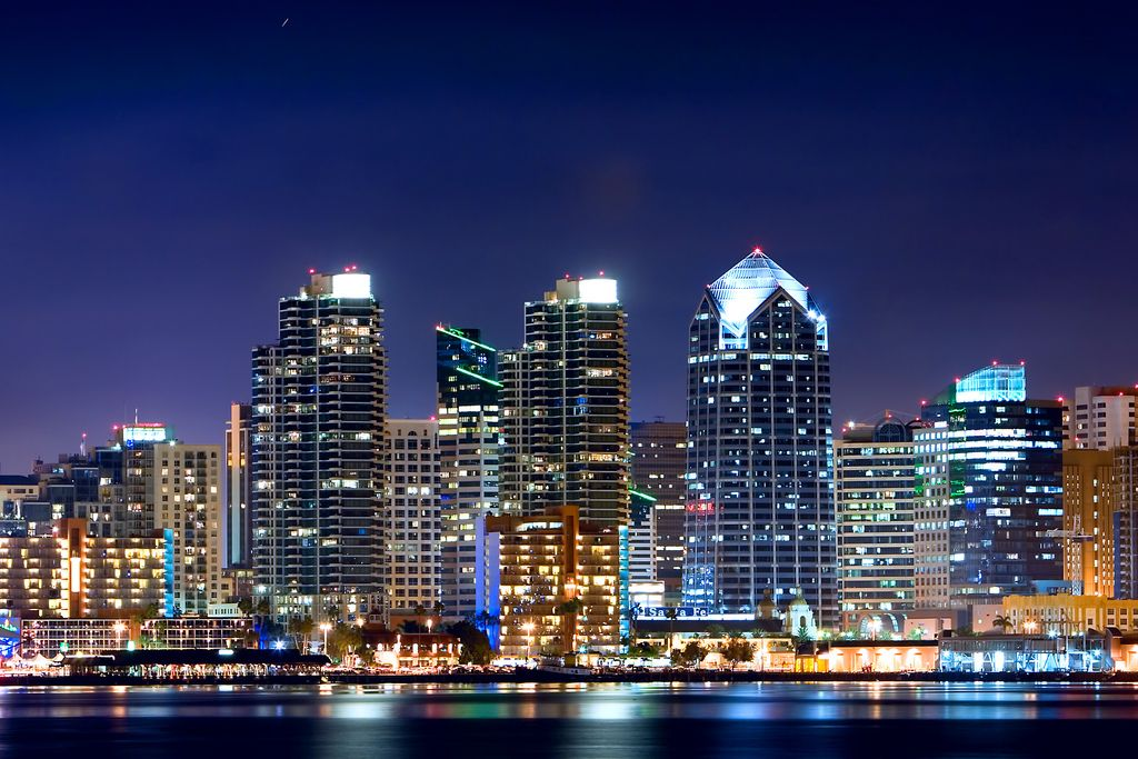 The Bright City Lights Of Downtown San Diego At Night As Viewed From Harbor Island San Diego Skyline Downtown San Diego San Diego City