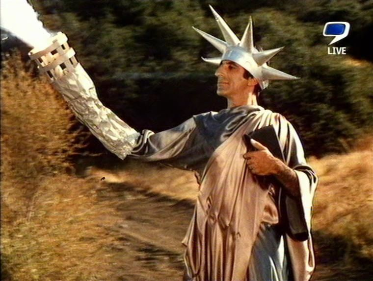 """M*A*S*H* The 4077th - Klinger appearing as """"Lady Liberty"""" upon General MacArthur's driving """"visit"""" thru the 4077th in """"Big Mac""""."""