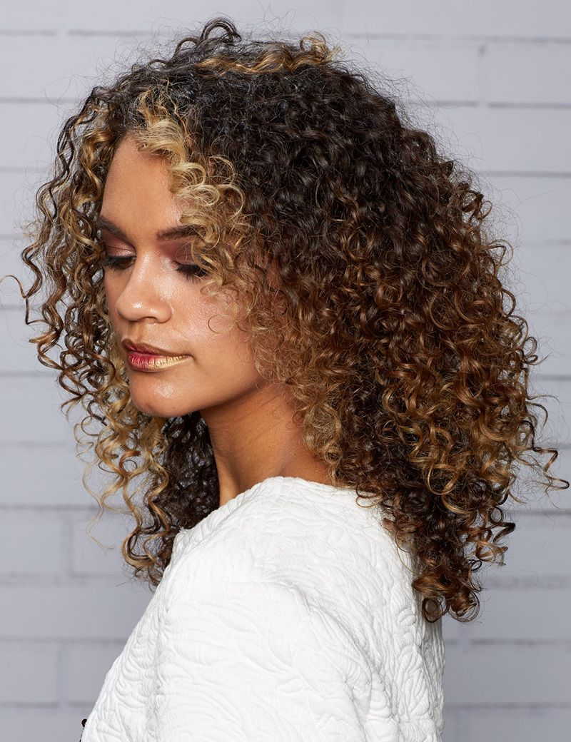 Medium length curly hairstyle for model girl latest