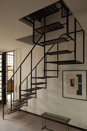 Pierre Chareau, La Maison de Verre in Paris, this all-metal floating staircase was designed by Chareau to lead from the doctor's office to his private study above
