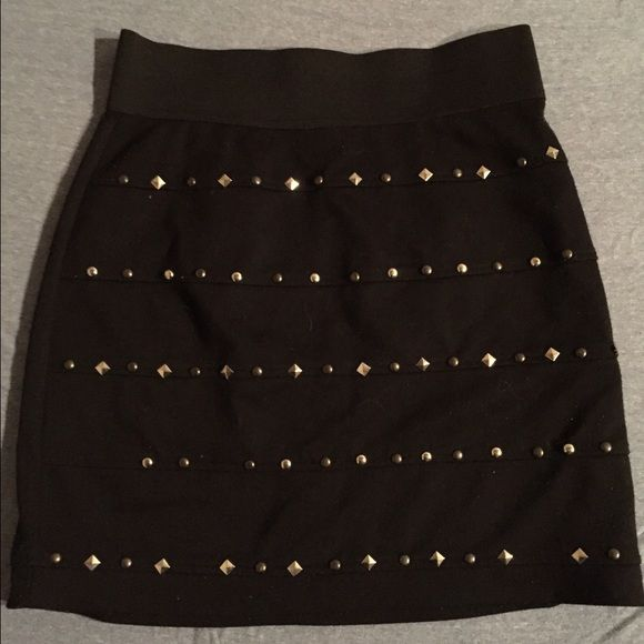 MISSING A FEW STUDS studded skirt has zipper in back, black, size medium. couple studs missing Skirts Pencil