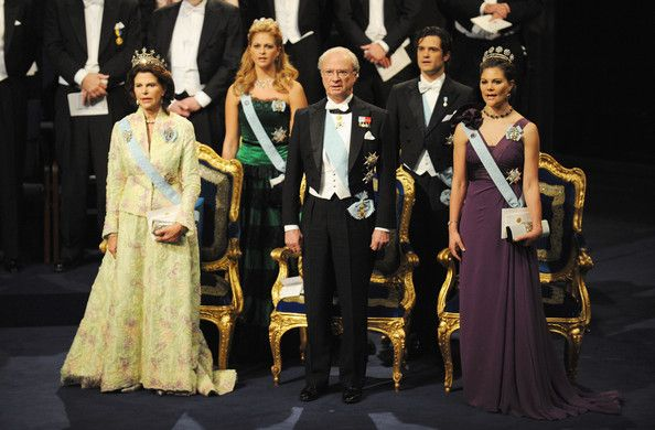 Princess Victoria Photos Photos - (L-R) Queen Silvia of Sweden, Princess Madeleine of Sweden, King Carl XVI Gustaf of Sweden, Prince Carl Philip of Sweden and Crown Princess Victoria of Sweden stand during the Nobel Foundation Prize Awards Ceremony 2009 at the Concert Hall on December 10, 2009 in Stockholm, Sweden. - Nobel Prize Award Ceremony 2009