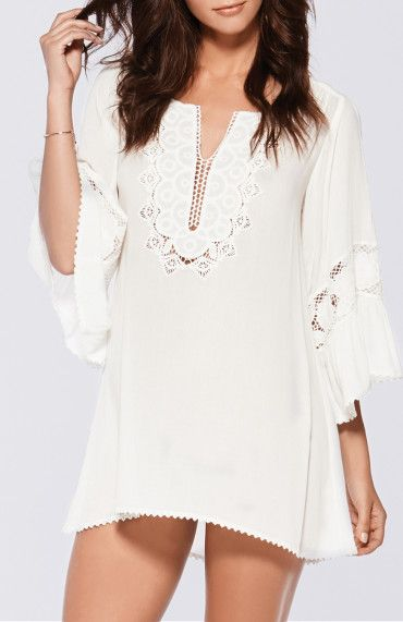 Beautiful bohemian tunic coverup with eyelet lace panels along the chest and sleeves and a slight high-low hem.