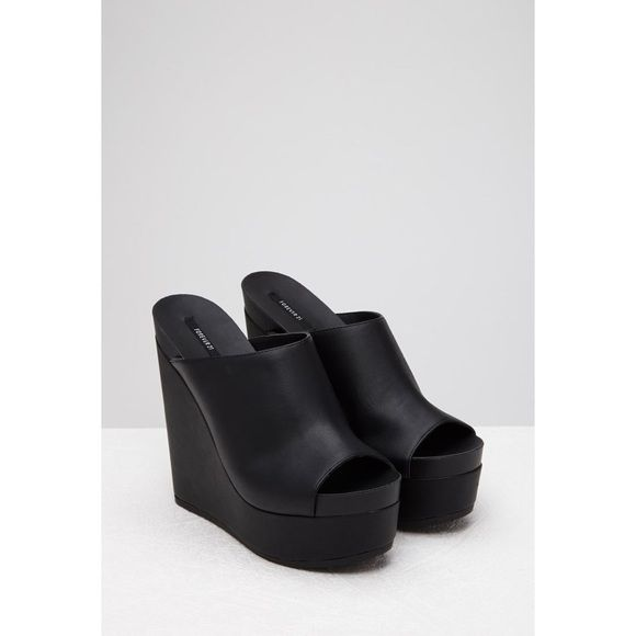 "F21 Faux Leather Platform Wedges ""These wedges give the term sky high a whole new meaning! With a chunky platform heel, this faux leather pair is slick, minimal, and adds an elevated, slightly edgy touch to your go-to looks."" Description pending Forever 21 Shoes Platforms"