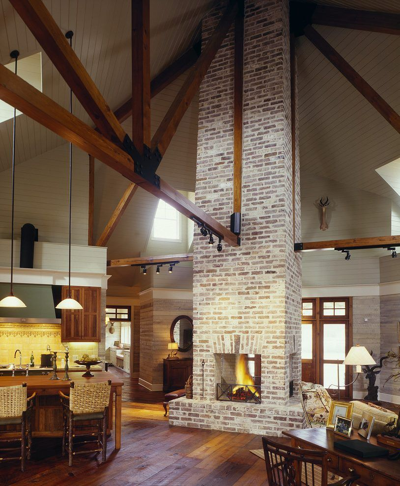 brick chimney living room farmhouse with truss traditional pendant