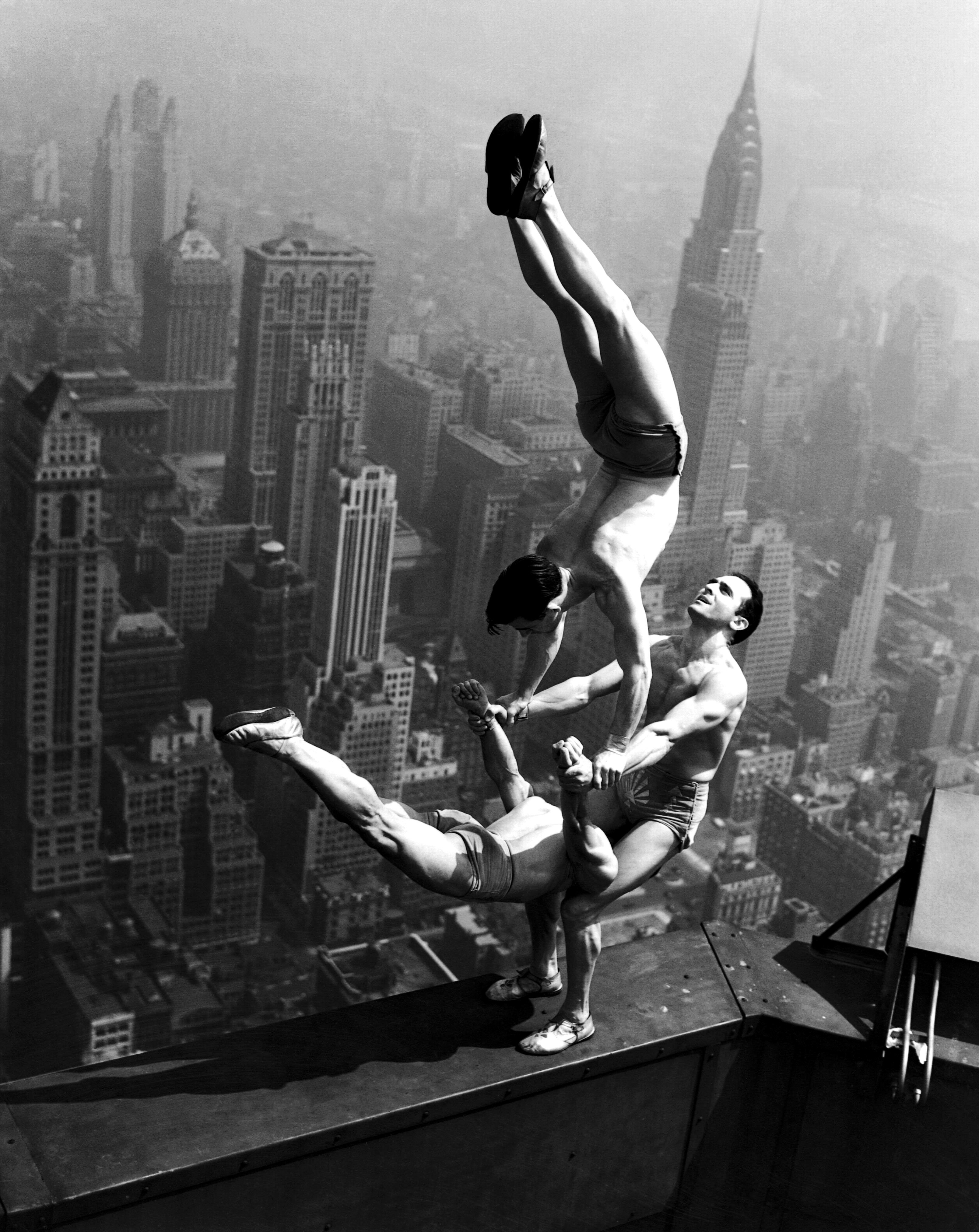 A Stunning Black And White Photo Capturing Acrobats At The