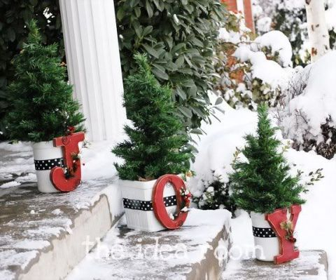This blogger planted trimmed shrubs inside of decorated planters. Each one displays a letter to spell out a warm greeting. See more at The Idea Room »