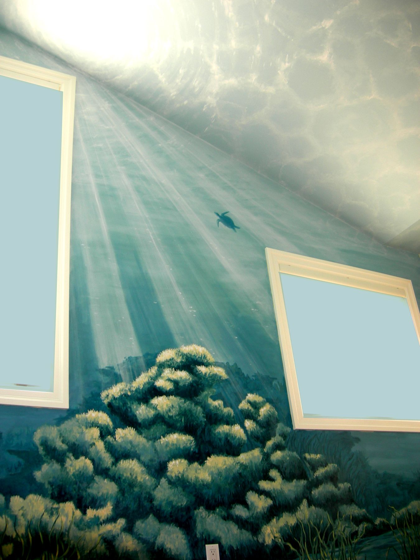 an underwater mural wall and ceiling view