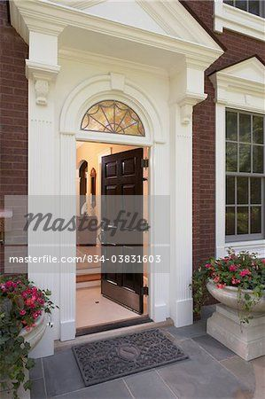 Front doors entrance to an elegant federal style home for Exterior door pediment and pilasters