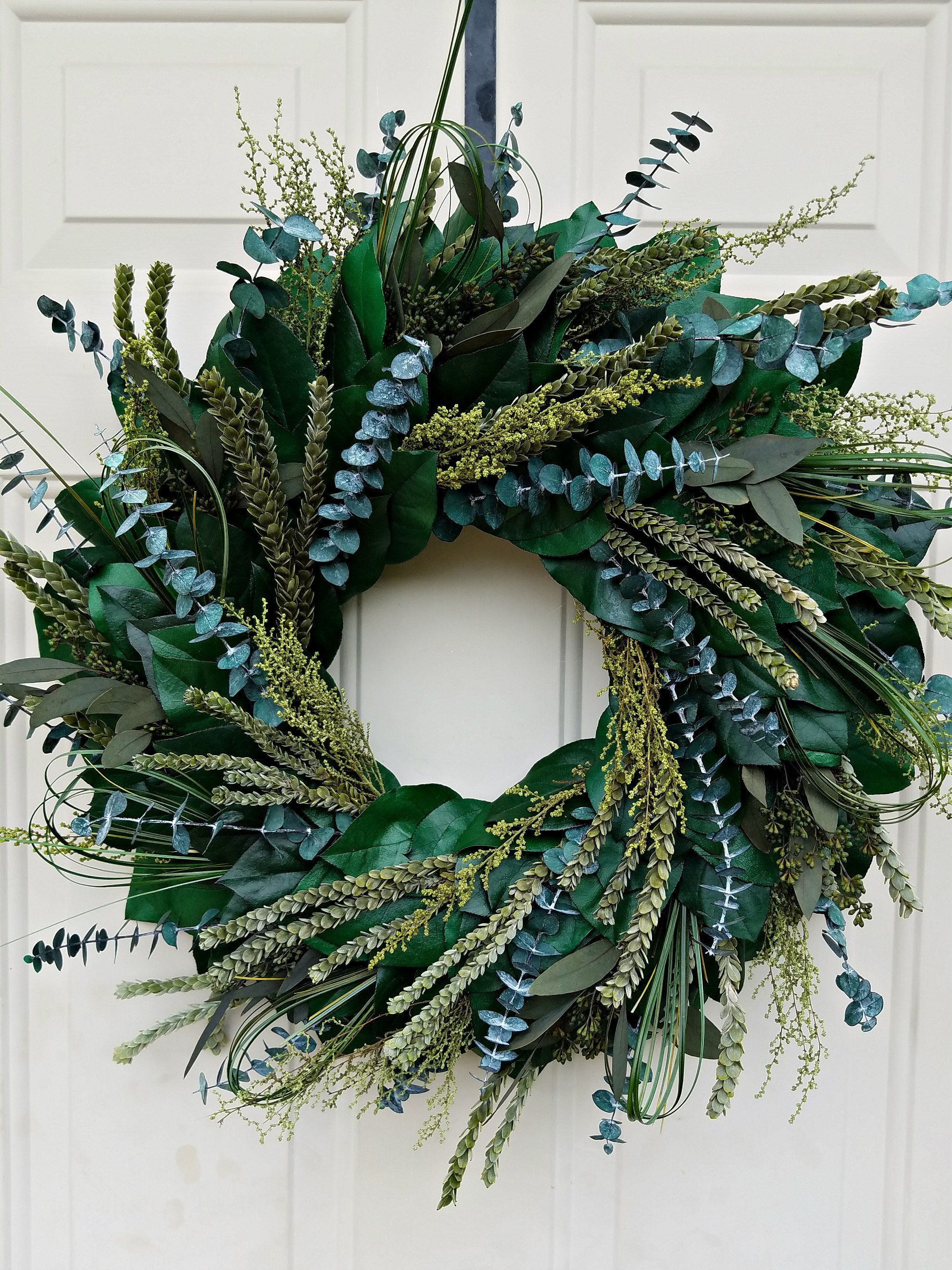 Photo of Farmhouse  style wreath made with all natural preserved materials and can last years.