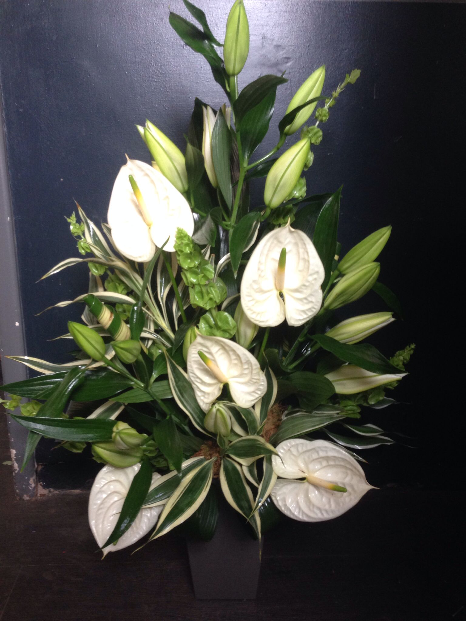 Front facing white anthurium and lily anthurium work