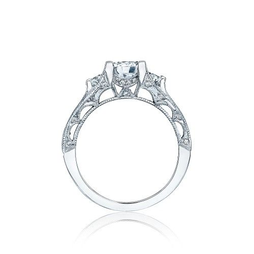 A star selection. This elegant platinum and diamond Engagement Ring is pictured with a round cut center diamond, flanked by round side stones,  and round channel set diamonds arching along the graceful profile. Pave-set diamonds accent the reverse crescent silhouette details.