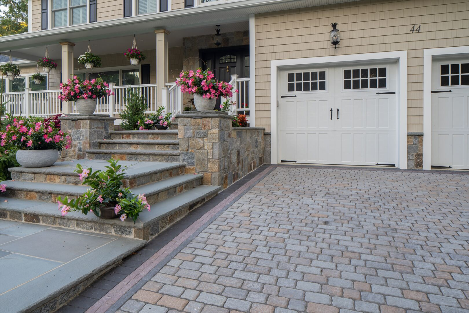 Create a driveway with a variety of our pavers to boost your curb appeal! Installation: Cardi Landscape  #driveway #curbappeal #outdoorliving #pavingstones
