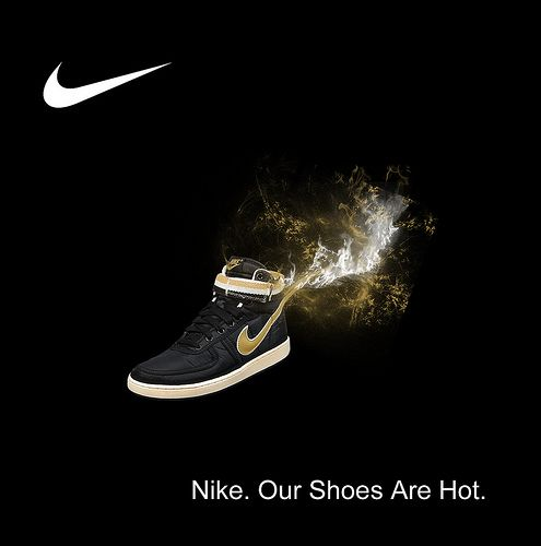 A Nike black & gold shoe that is ON FIRE!