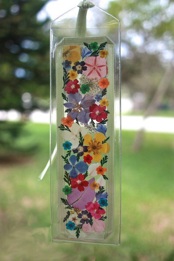 THIS BOOKMARK is a second version of my original Multicolored Pressed Flower Bookmark. It is clear and the light can be seen shining through