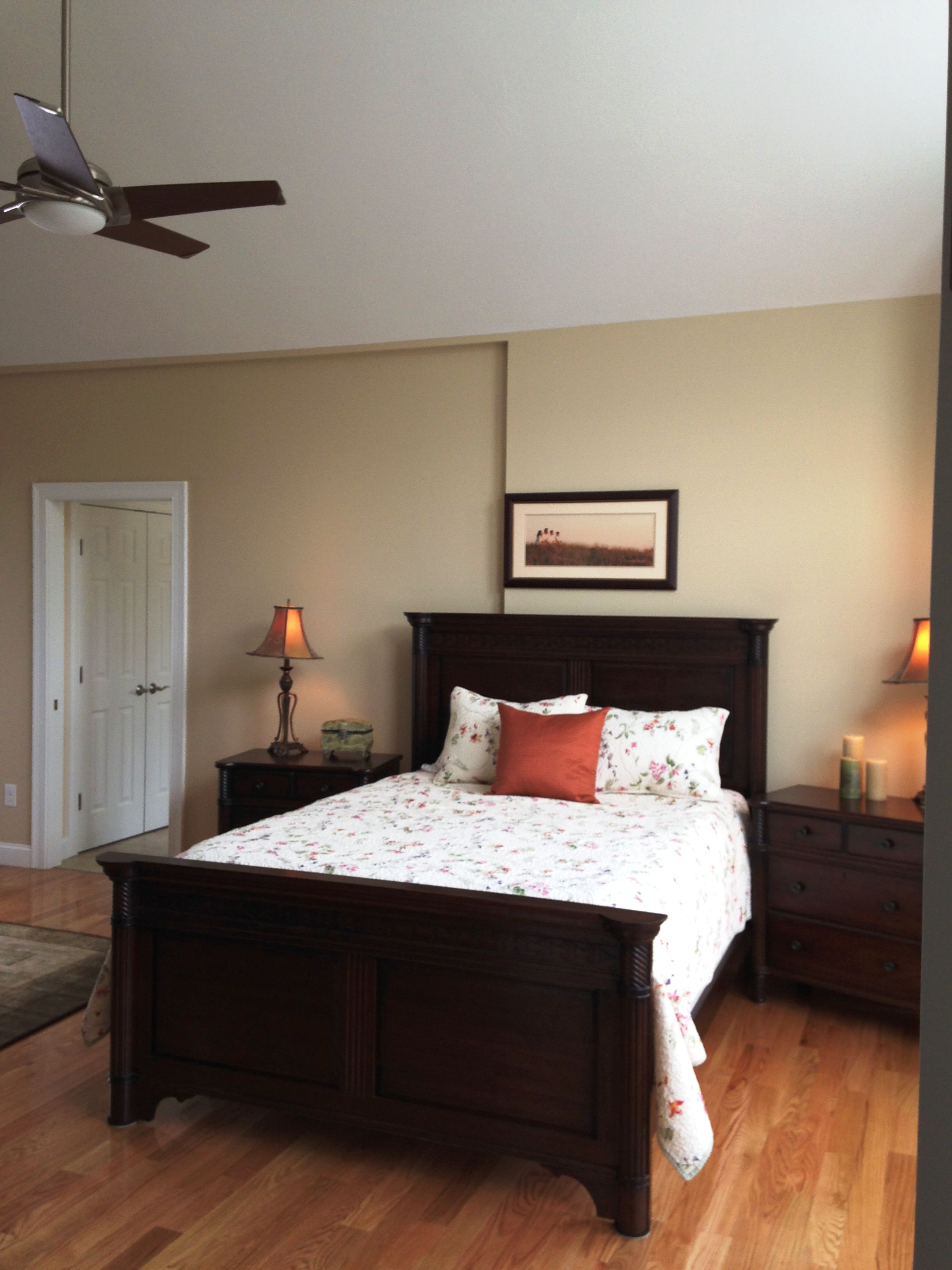 Master Bedroom With Ceiling Fan Hanging From The Center ...