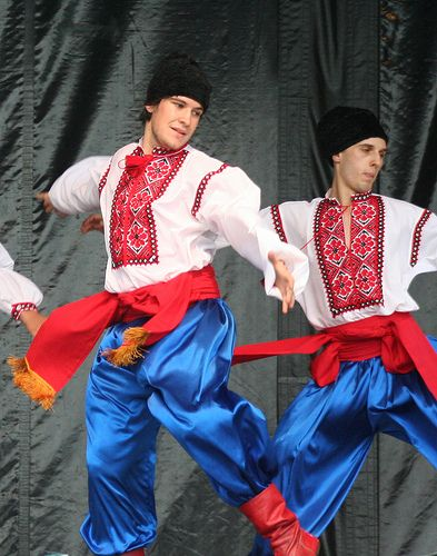"""Hopak: """"Ukraine's national dance is the hopak, a very energetic ensemble where women spin and encircle the men, who perform a number of difficult acrobatic stunts in the front, including the well-known squat kicks and split jumps of the Cossacks."""" Read more in Ukraine: The Bradt Guide www.bradtguides.com"""