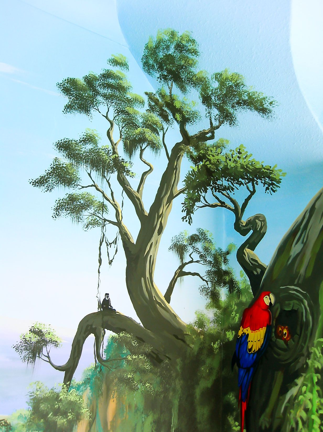 Parrot and a monkey in a couple of trees Jungle mural