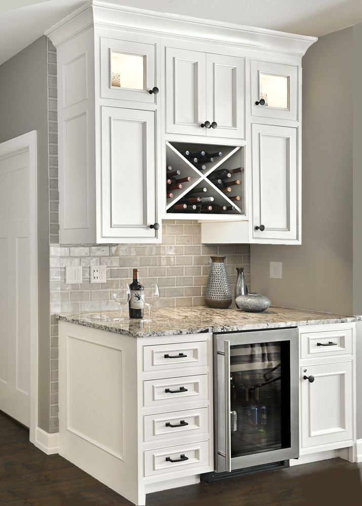 "Custom beverage center with ""X"" wine rack and small refrigerator ..."