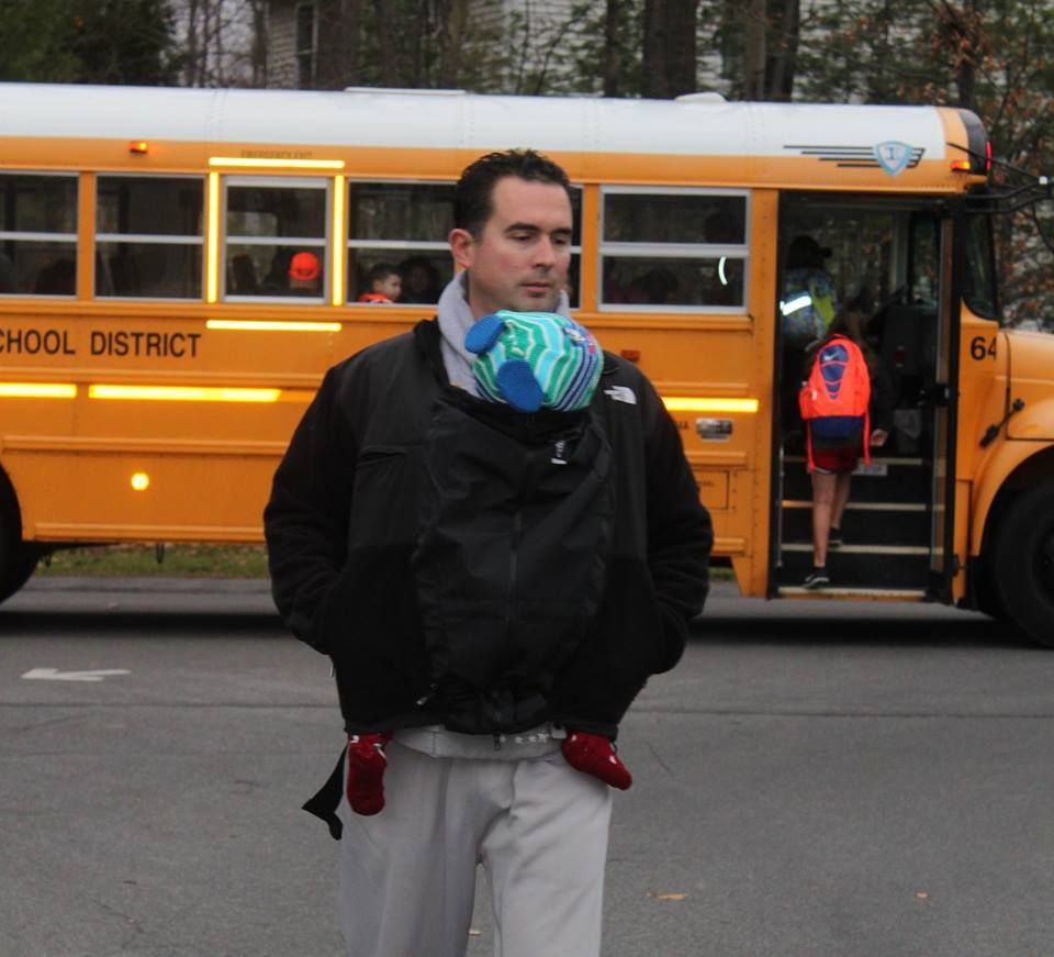 Going to the bus stop with the older kids is less of a struggle when you have the baby in his front carrier, all snuggled in your jacket! Just clip it on to your jacket  ahead of time and when its time to go, just zip yourself and the baby in. www.theextendher.com