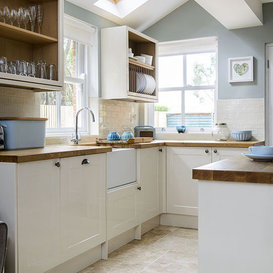 White Kitchen Units With Oak Worktop: Cream Cabinets, Brick Tiles, Wood Worktop